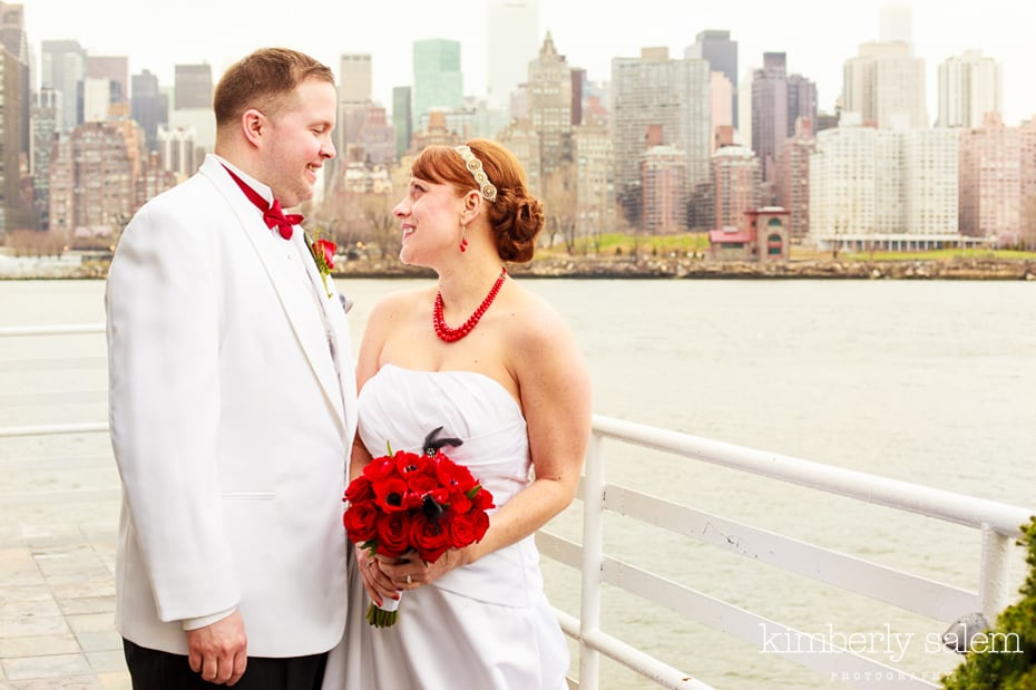 bride and groom with Manhattan view in background - Water's Edge