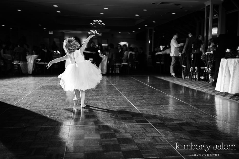 flower girl dancing alone on the dance floor