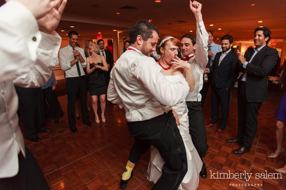 bride and groomsmen dancing