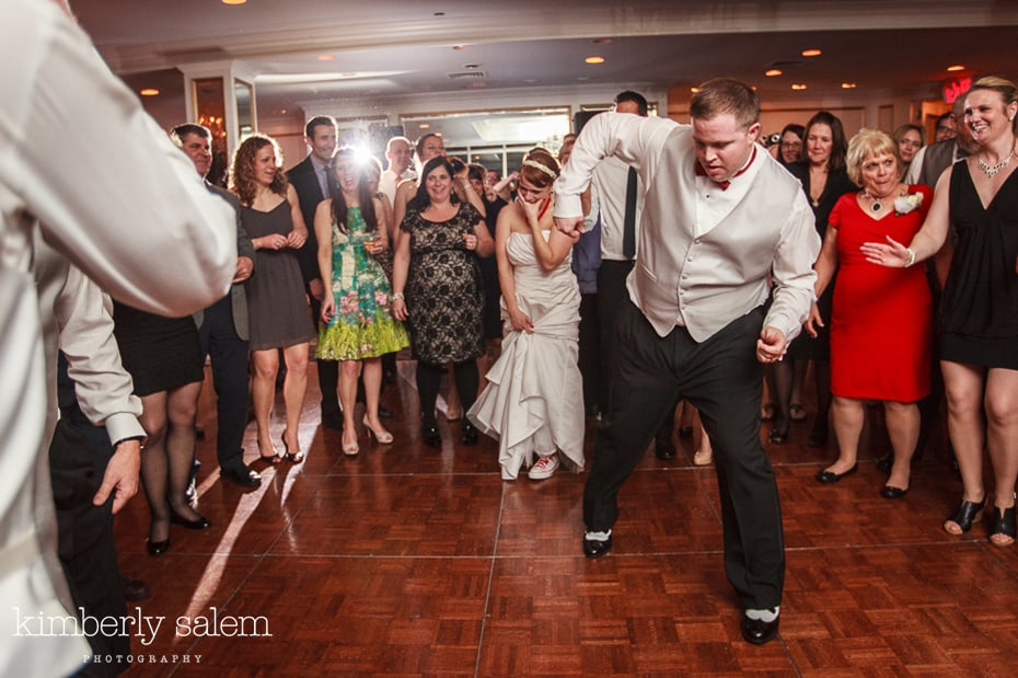 groom dancing the robot while bride watches