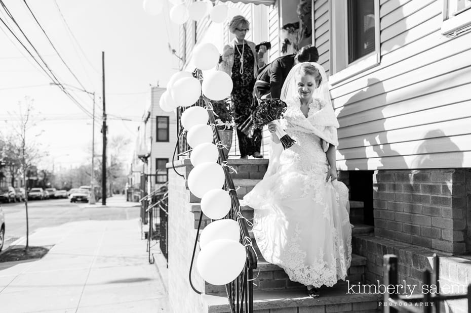 bride walking down stairs - white balloons