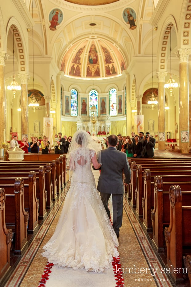bride and her father walking down the aisle in church