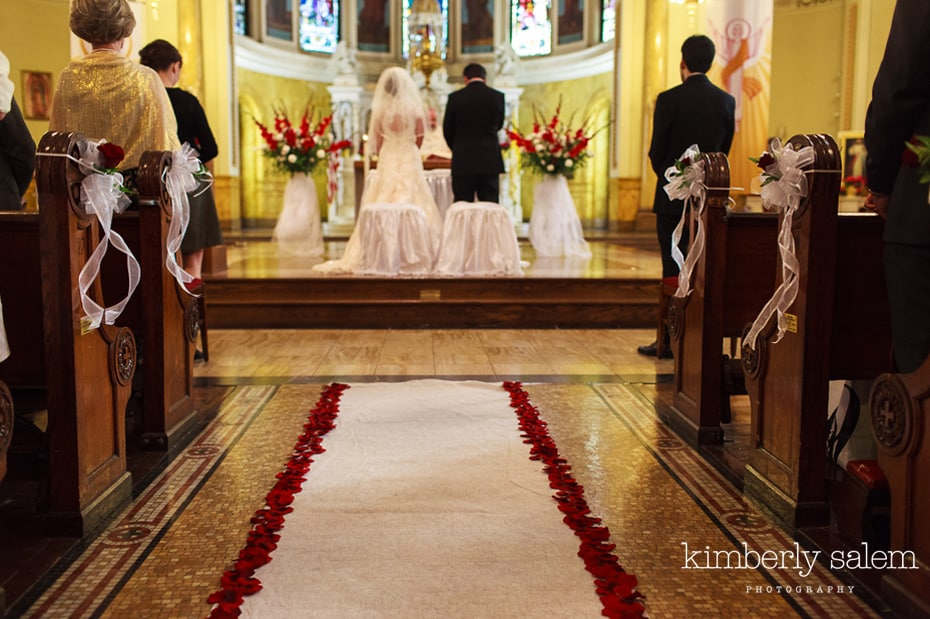 red rose petal aisle runner - church wedding