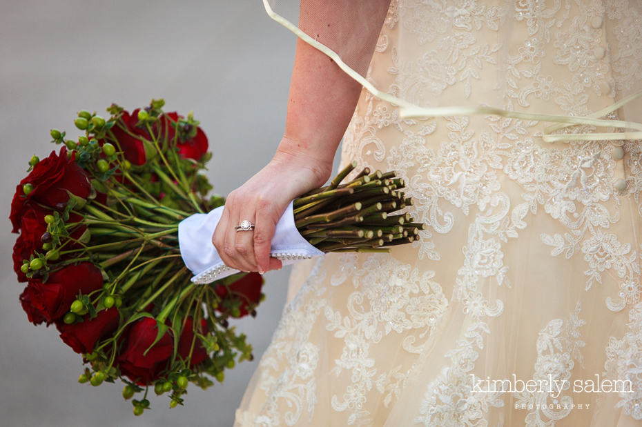 wedding bouquet detail with wedding rings and dress