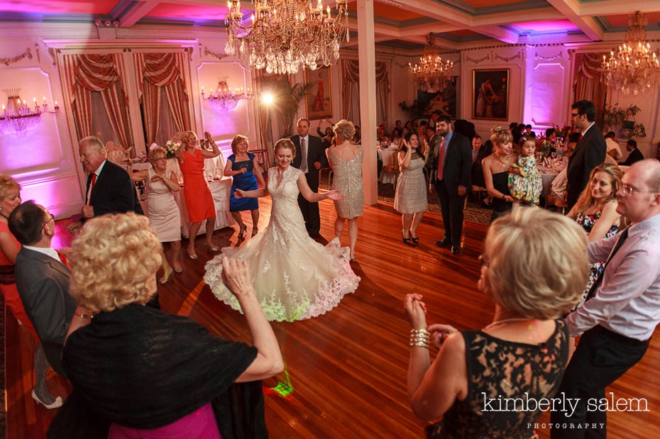 bride's dress flares out as she dances