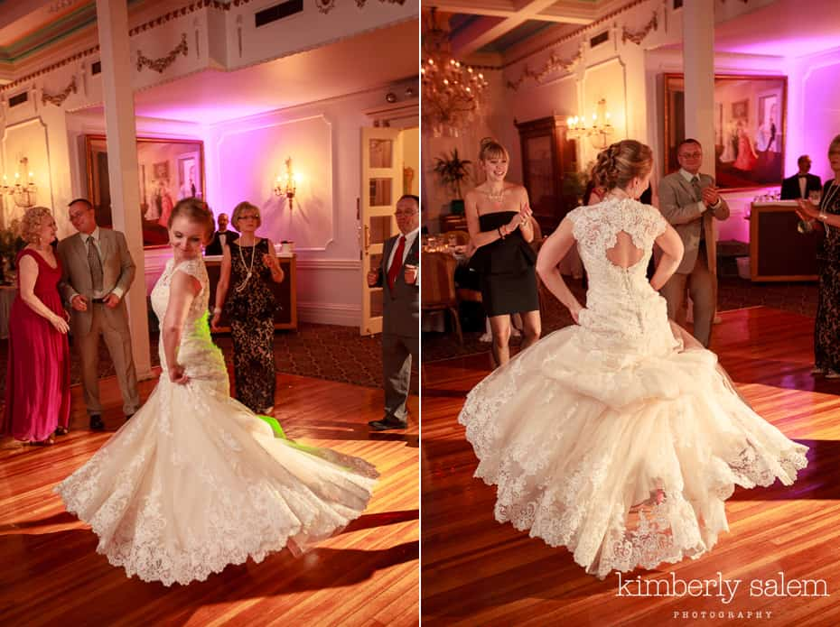 bride dancing - lace dress flares out