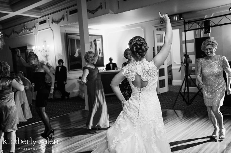 bride dancing with arm in the air