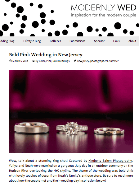 engagement ring and wedding rings with reflection and pink background