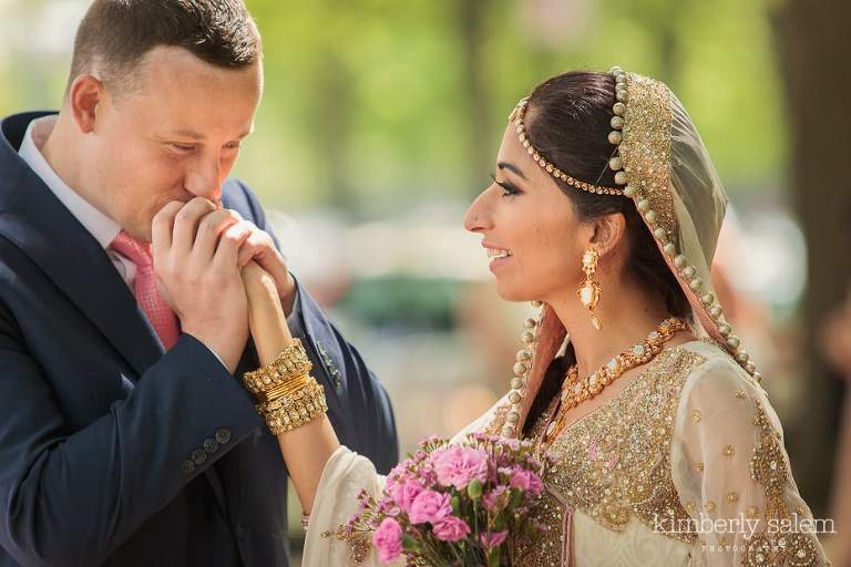 groom kisses bride's hand during First Look
