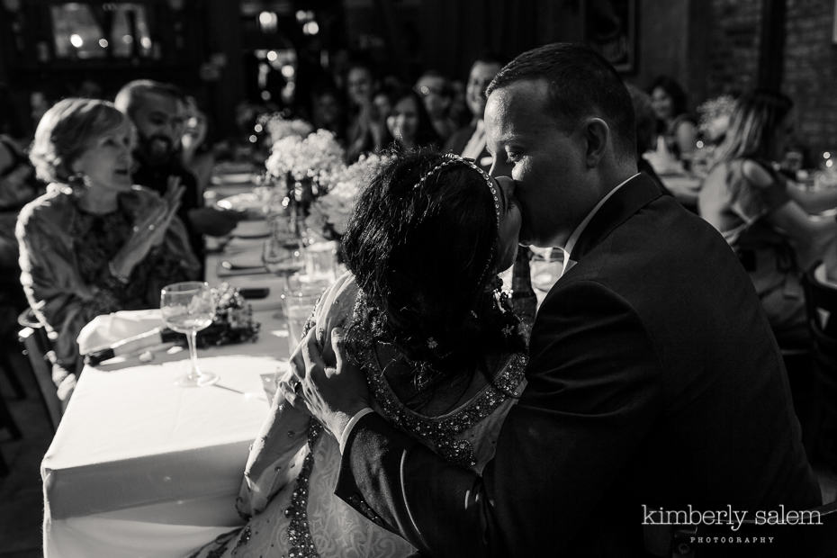 bride and groom kiss after their first dance