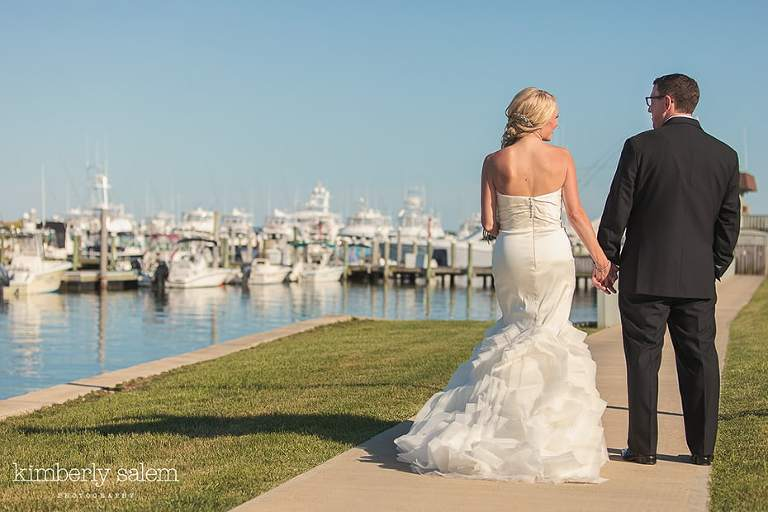 Bride and groom with boats in the background