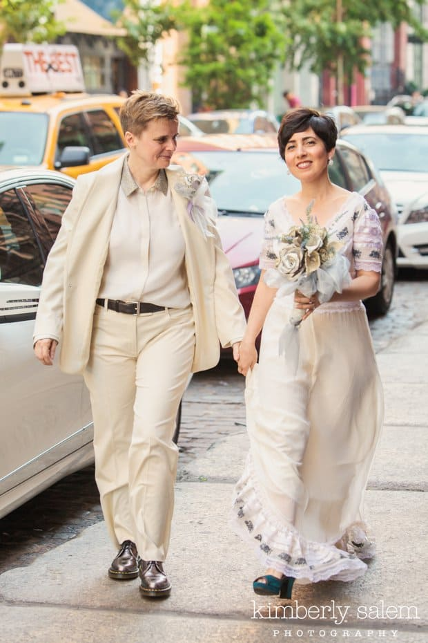 Brides walking along the sidewalk with NYC taxi in background