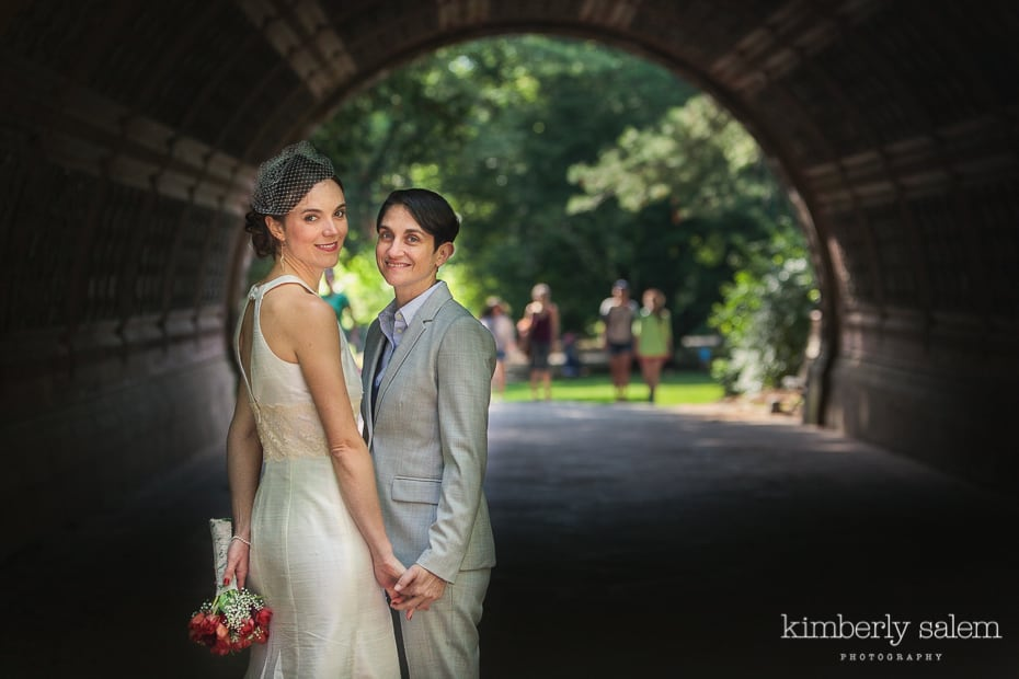portrait of two brides in prospect park - in tunnel