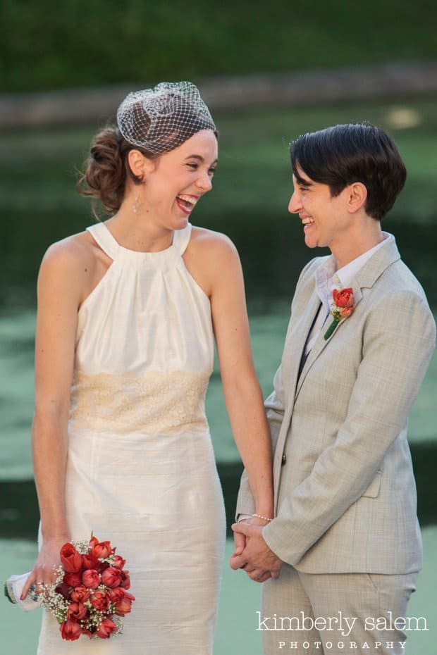 two brides laughing during their wedding ceremony