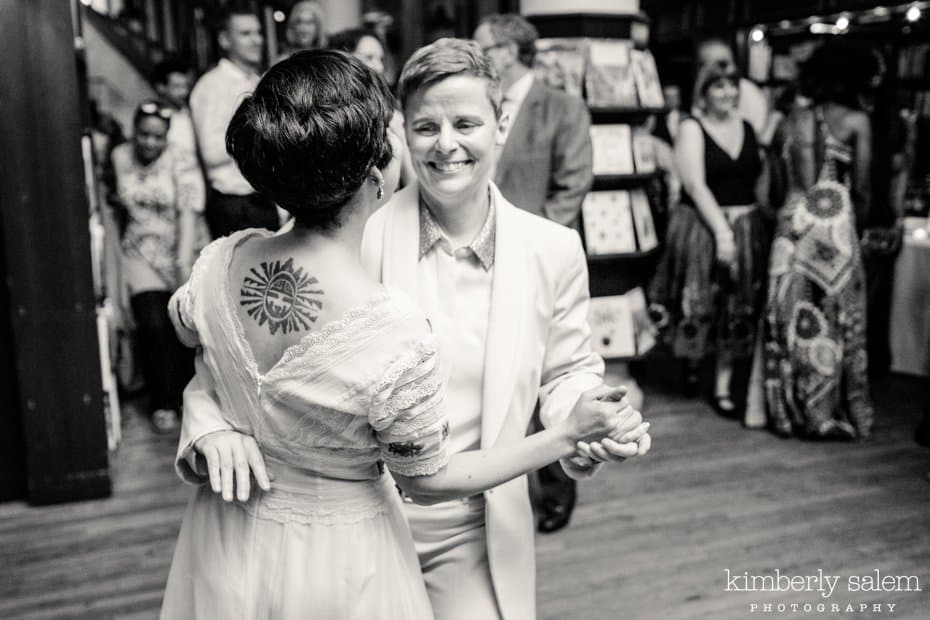Brides smile during their first dance