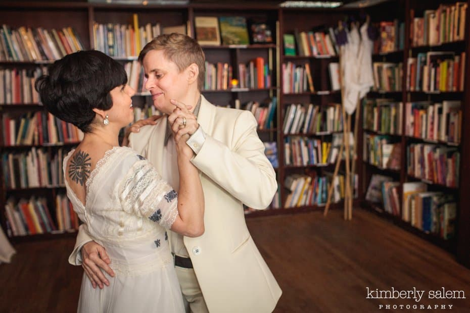 Brides during their first dance in the Housing Works Bookstore