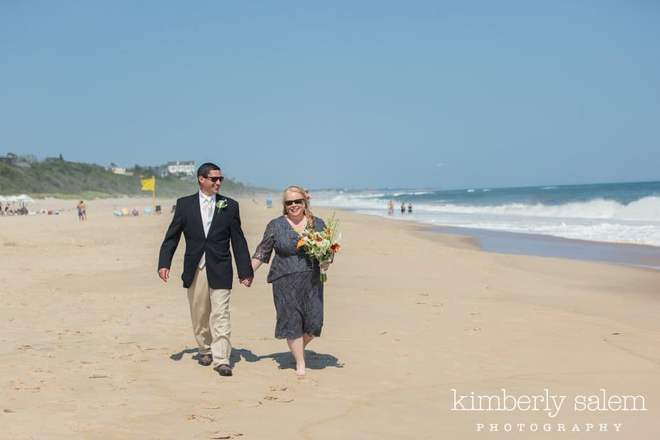 bride and groom walking on the beach at Montauk