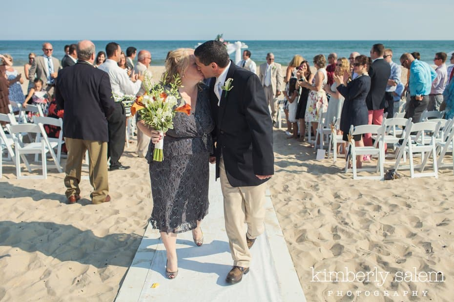 bride and groom kiss after beach wedding ceremony at Montauk