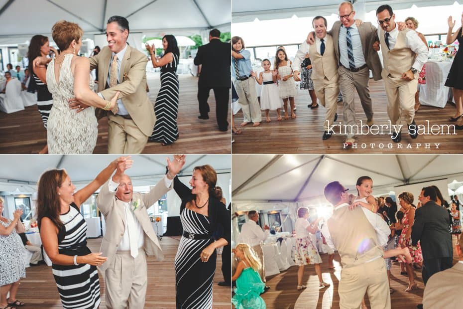 guests having fun dancing at the beach themed wedding reception