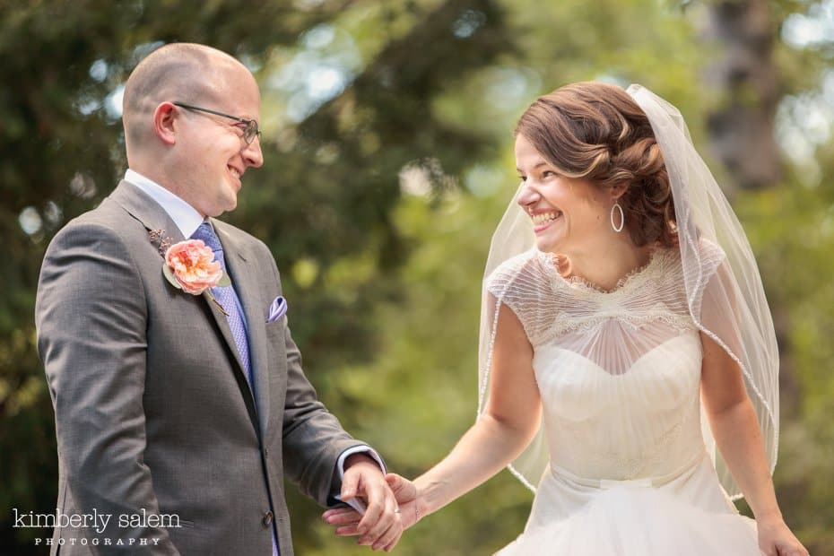 Bride and groom share a laugh after their wedding ceremony