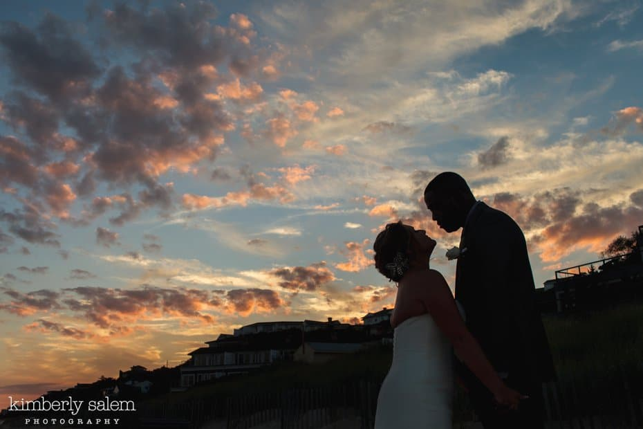 bride and groom sunset silhouette on the beach in Montauk