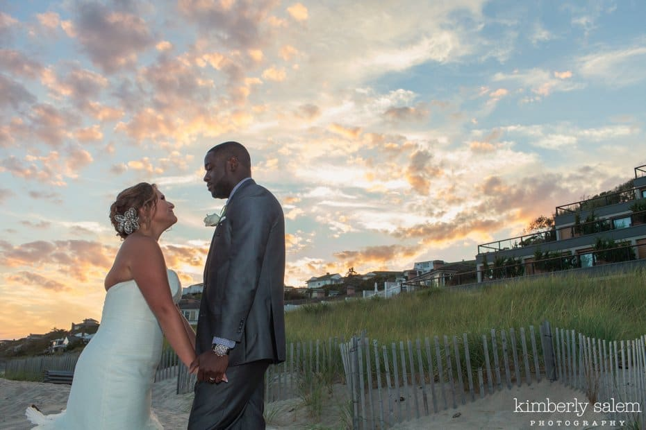 bride and groom portrait with sunset in background