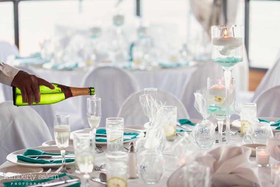 reception table details - white and blue - champagne pour