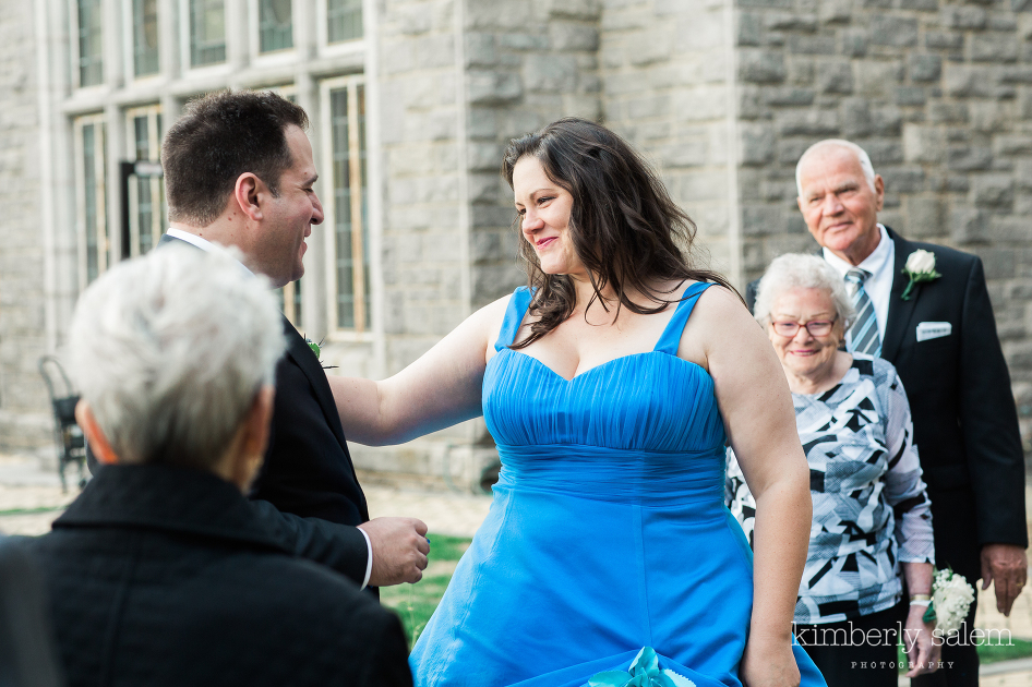 blue dress bride and her groom during handfasting ceremony